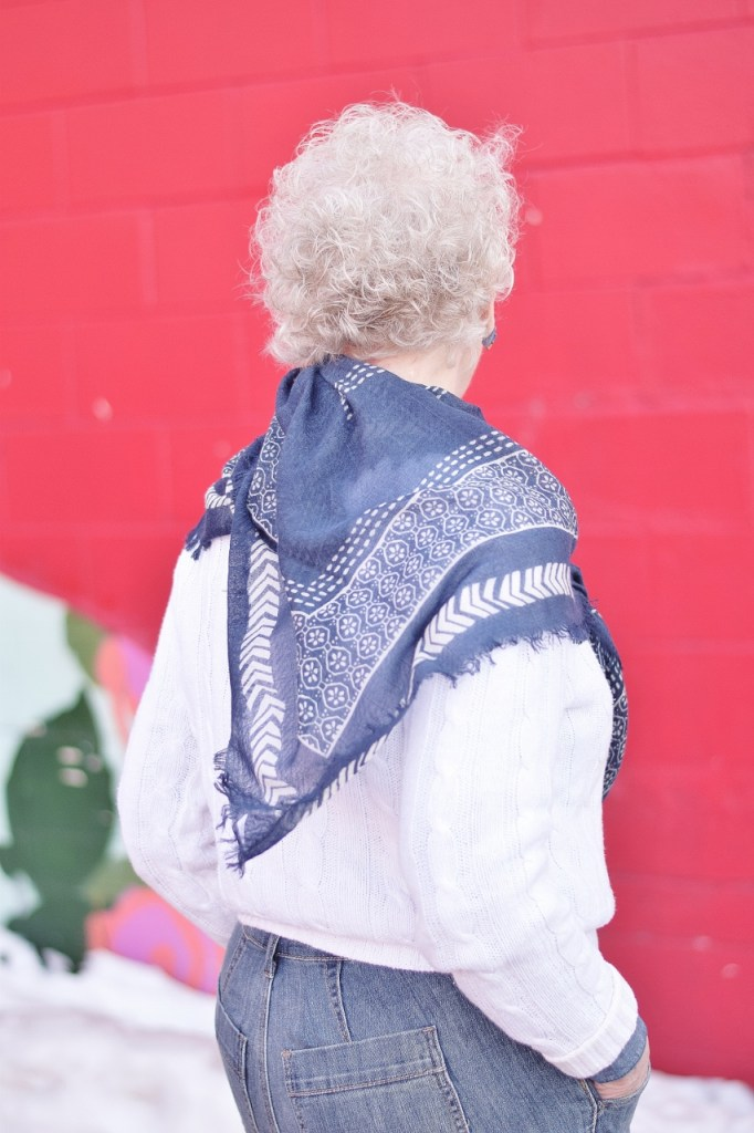 RockFlowerPaper and woman over 80 wearing scarf tied differently