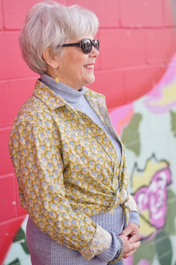 RockFlowerPaper and woman over 60 showcasing a top