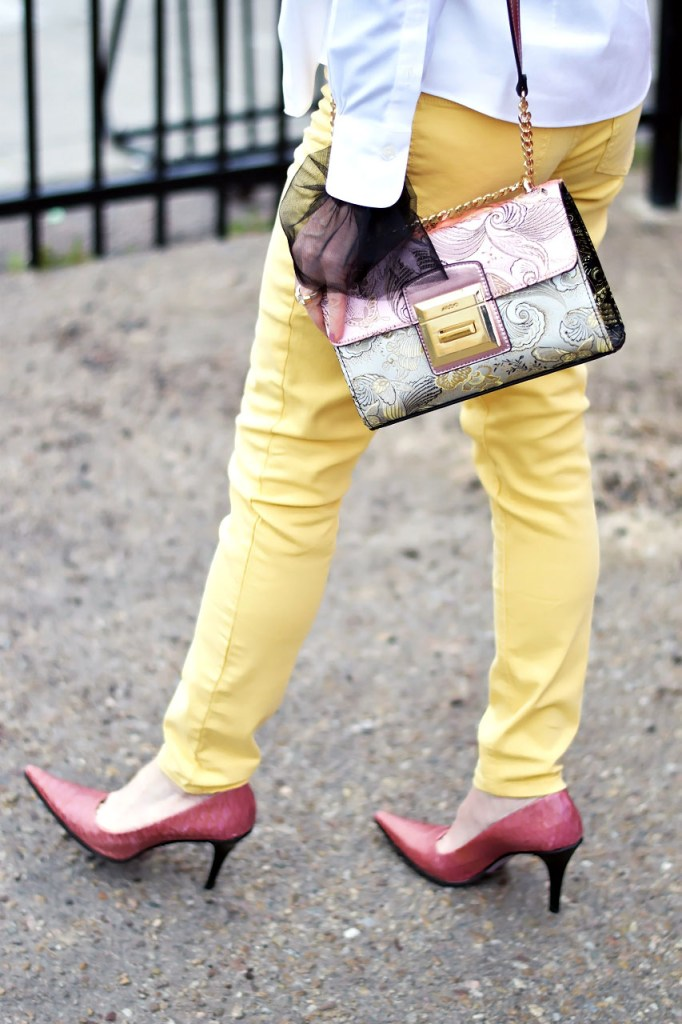 Wearing a White button down with pink and yellow