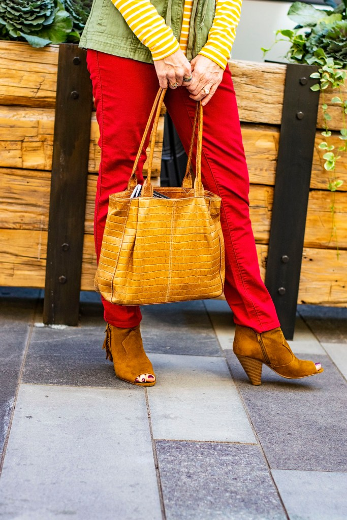 Styling fall colors for outfits red jeans