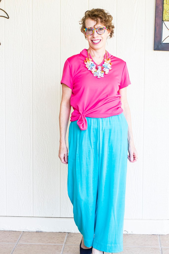 Statement necklace with wide leg pants for curvy women