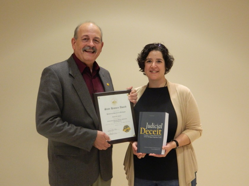 Author David Schock and editor Amee Schmidt pose with the book and the award. Co-author Chief Justice Elizabeth A. Weaver was deeply missed at the ceremony. Photo courtesy of Nancy Feldbush, Historical Society of Michigan.