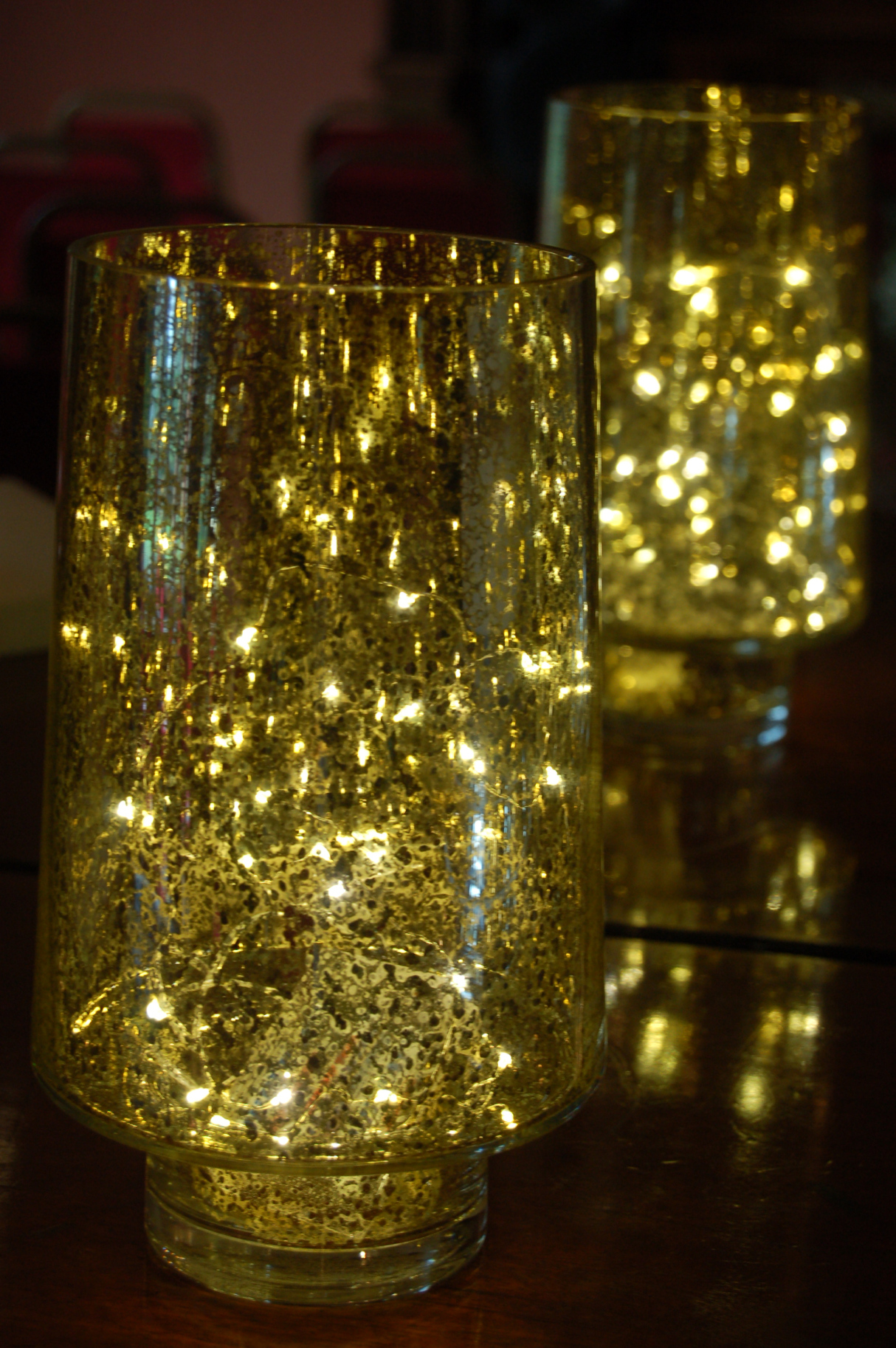 Hurricane Vases lit with strings of twinkling lights