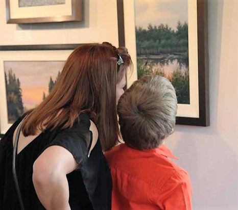 I believe they are counting the Blackbirds in the painting for the scavenger hunt.