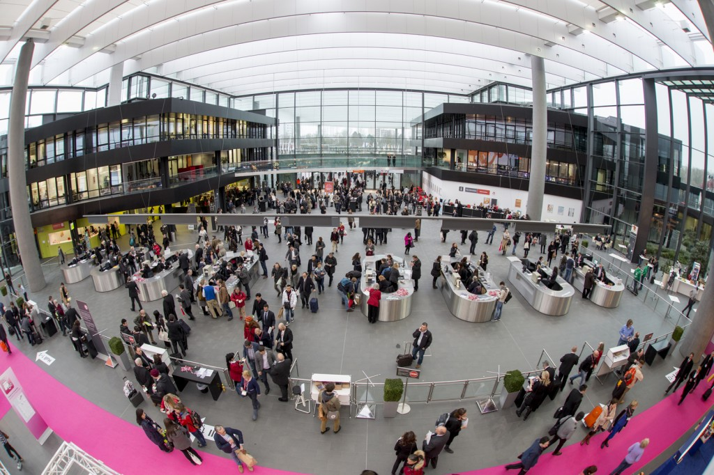 Visitors enter the Toy Fair at the Central Entrance