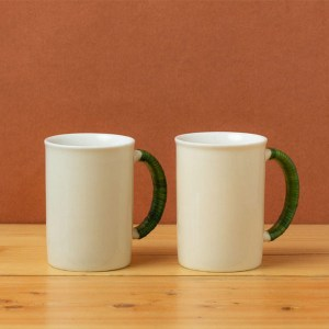 Stoneware-mug-Gardenia-Mug-in-Ivory-White-with-Green-Wicker-Set-of-2