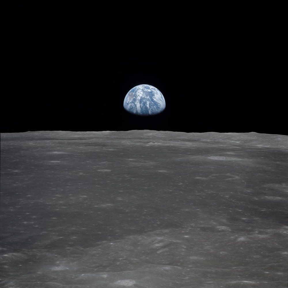 Apollo 11 Mission image - View of moon limb,with Earth on the ho