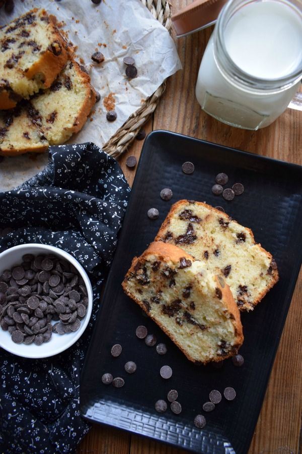 Table setting of the Chocolate Chip Loaf Cake with a glass of milk
