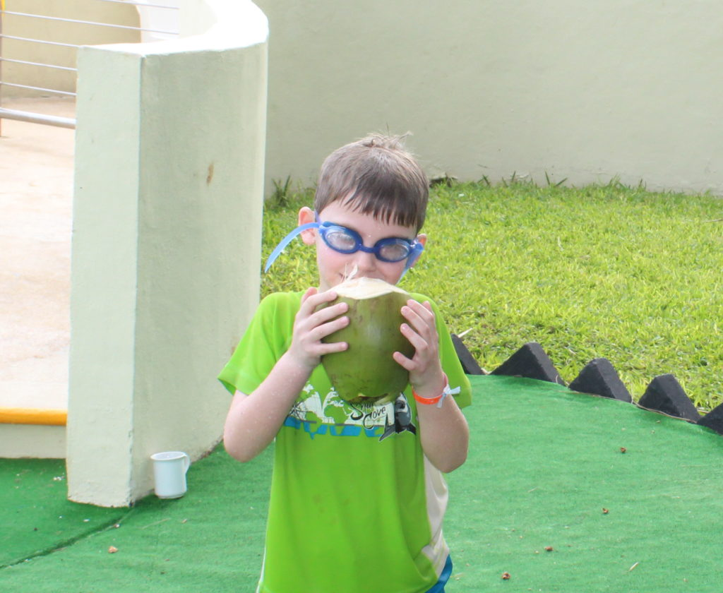 child with coconut