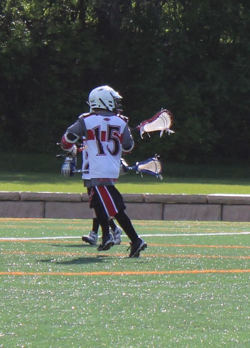 Lacrosse game. Boys playing sports. Boy momlife.