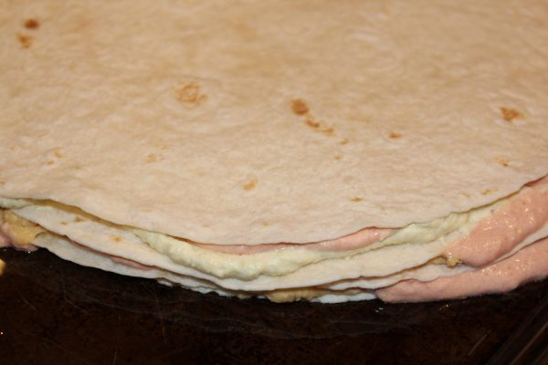Spread mixtures 2 and 3 on the tortillas