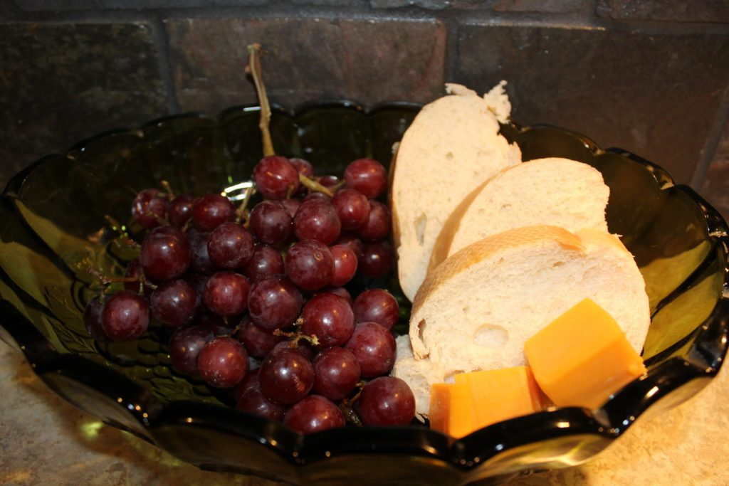 St. Urho's Day Kids snack in bowl french bread, grapes, cheese