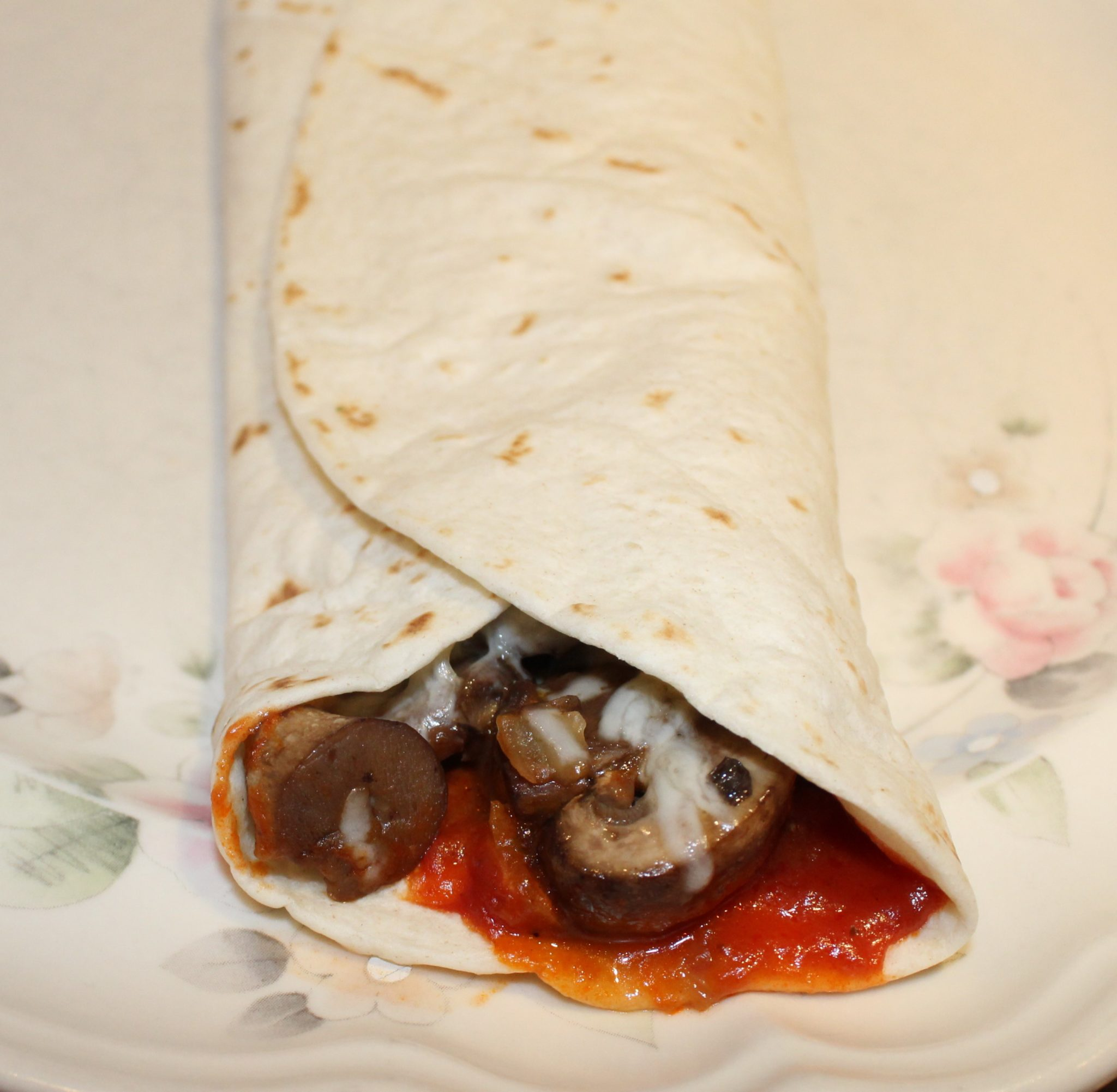 Easy Pizza Tortilla Roll recipe for one to four people.