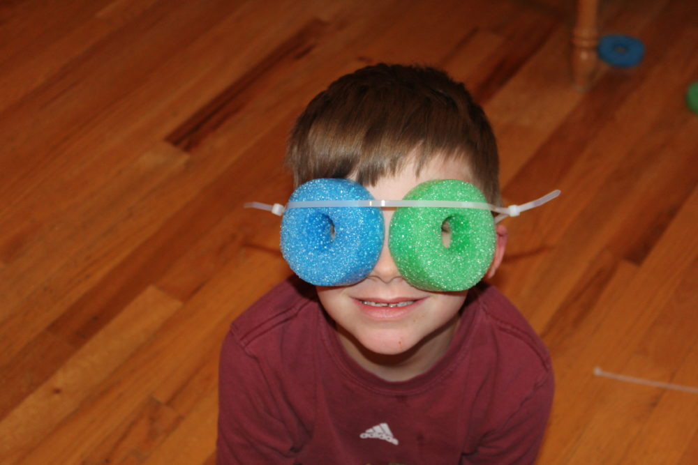Creative fun with pool noodle pieces and zip tie headband to make glasses