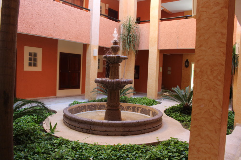 Courtyard of our room's building. Grand Palladium Riviera Maya, Mexico. All-inclusive resort. Family Travel.