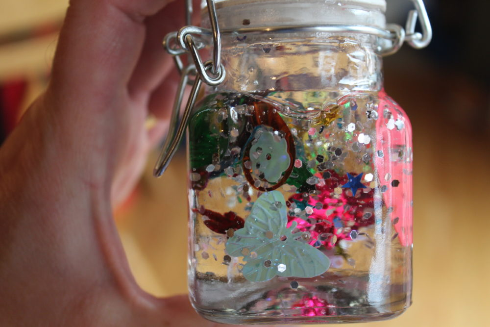 Small jar with butterfly spangle visible.