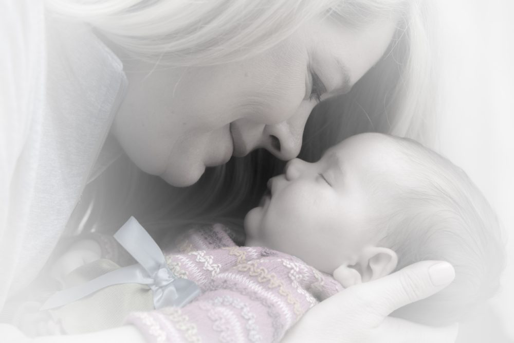 Mom and her newborn baby. The truth of the importance of Postnatal Supplementation for the health of baby and the mom.