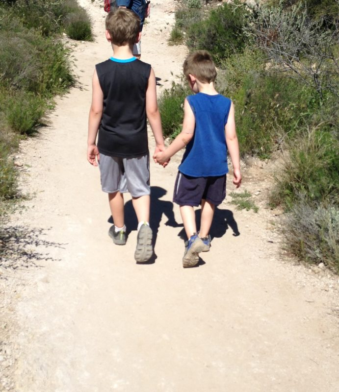 Holding hands on a desert hike Superstition Mountains Arizona