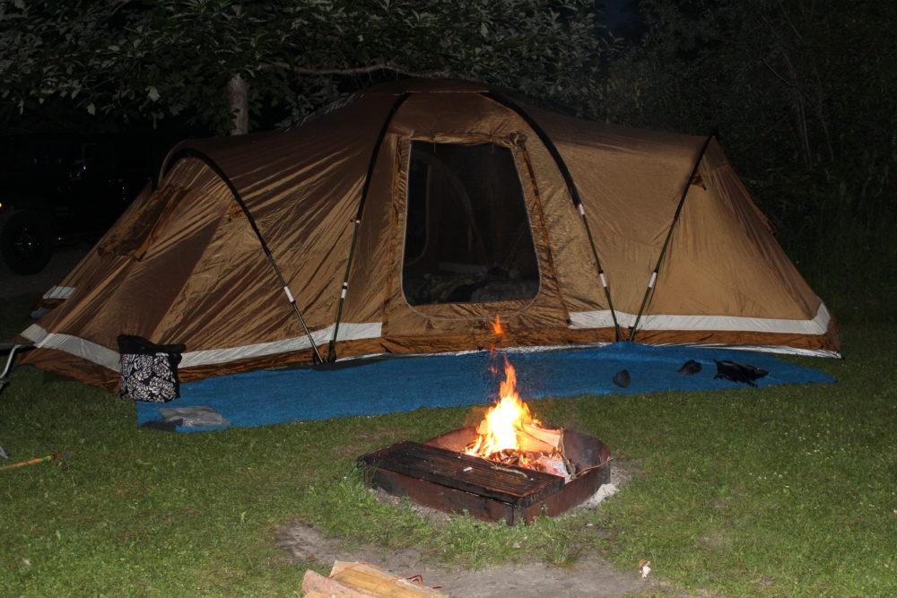 Tent and bonfire at night