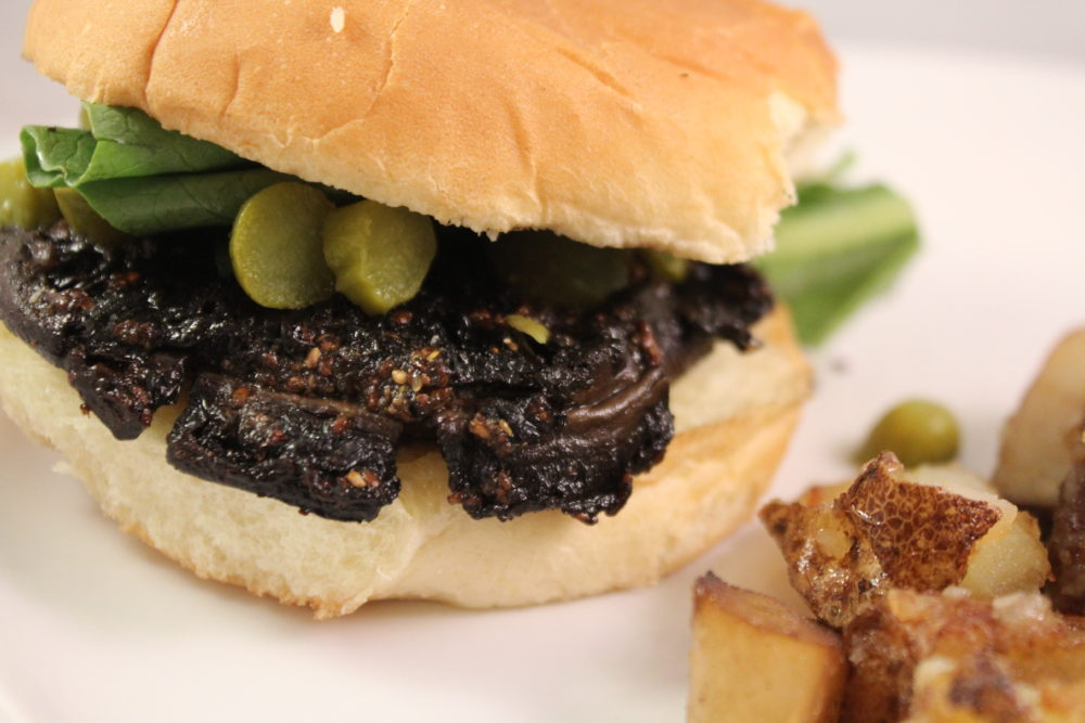 Marinated Balsamic Mushroom Cap Burger with lettuce and pickles
