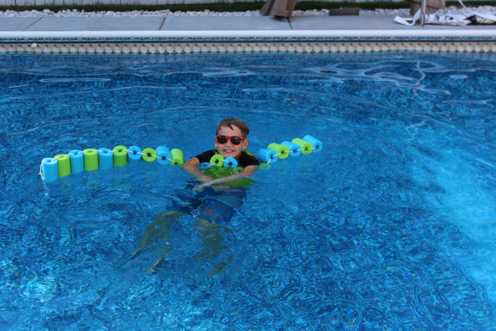 Using DIY Pool Noodle Float Ring in the pool