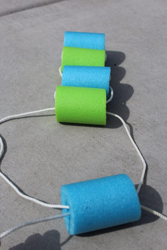 String both rope ends through the pool noodle hole.