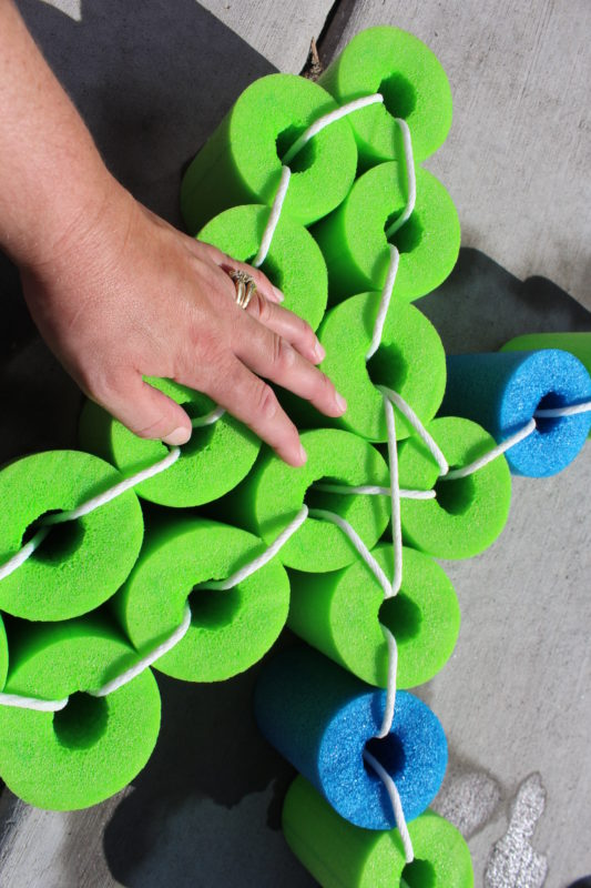 Tie these four green pool noodle sections together to make the fish tail