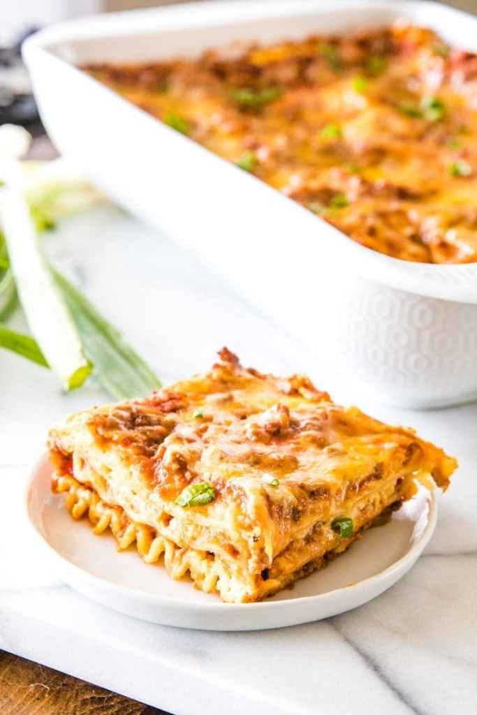 How to make Mexican Lasagna Recipe with a slice of Mexican Lasagna on white plate