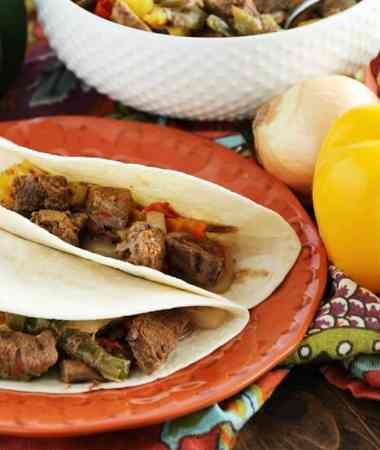 Crock Pot Steak Fajitas ~ Loaded with Steak, Red Peppers, Green Peppers, Yellow, Peppers, Onions and Spices! Piled High on a Tortilla Shell! The Perfect Quick, Easy Weeknight Recipe!