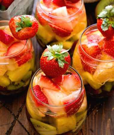 Rainbow Sangria Recipe ~ Delicious, Fruit Sangria that has all the colors of the Rainbow! Simple, Easy and the Perfect Drink to Relax with!