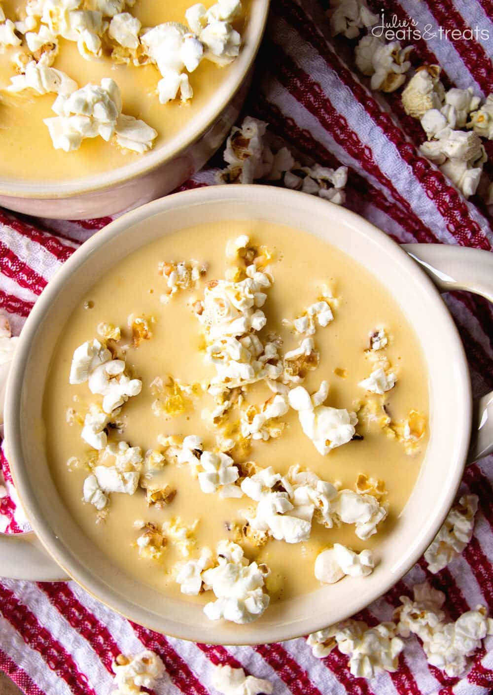 Beer Cheese Soup topped with popcorn in bowl