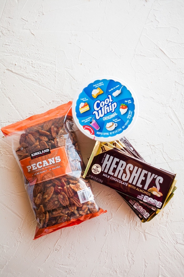 Ingredients for meltaways; nuts, cool whip and chocolate bars.