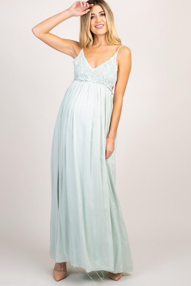 e326dfc1a52 Mint Green Lace Top Pleated Waist Backless Maternity Maxi Dress  A solid  hued backless maternity