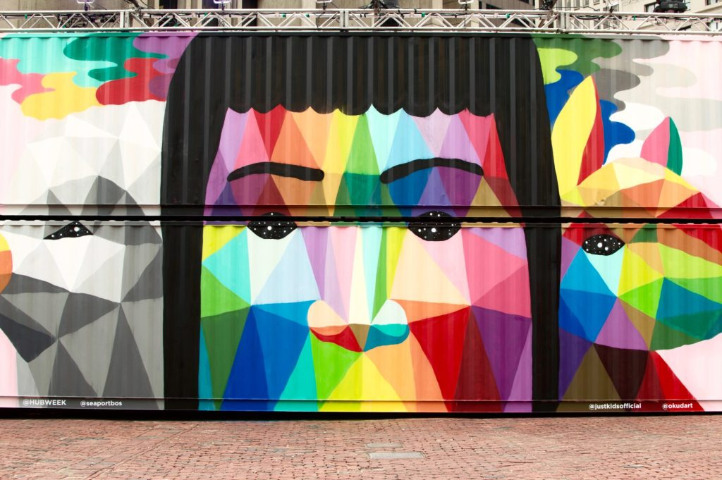 Geometric portrait painting on shipping container