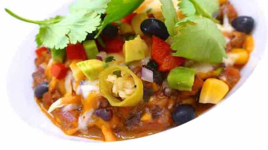 My cheesy Mexican style black bean dip, a sizzling hot and spicy bean dip with melted cheese on top... Dig in before it's too late!