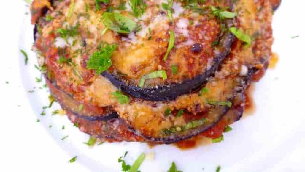 I adore this eggplant parmigiana recipe! Fried eggplant with parmesan cheese in tomato sauce, then oven baked... A great Italian dish!