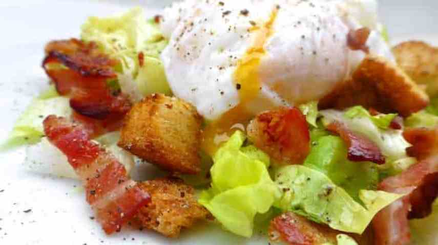 Classic salad Lyonnaise: a French salad with soldiers (croutons in French), bacon, poached eggs and a simple mustard dressing.