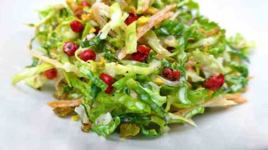 My crisp savoy cabbage salad recipe: a crunchy slaw with fresh carrots, pink peppercorns and a light buttermilk dressing...