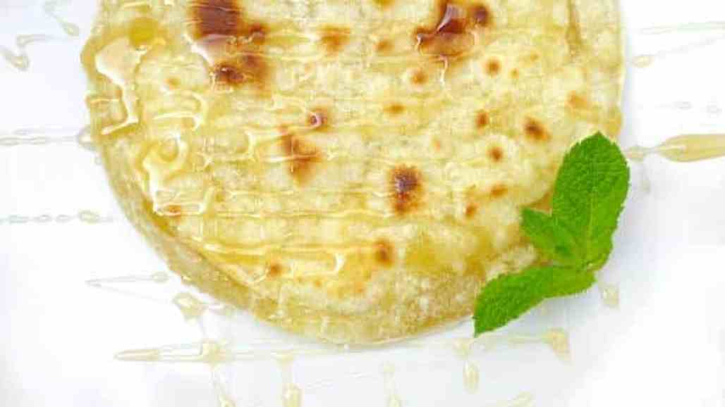 Sfakiani pita: a sweet delicacy from the Mediterranean island of Crete! A cheese stuffed flatbread drizzled with honey, a great dessert!