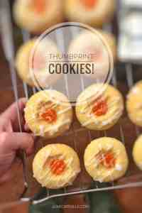 Sugary soft cookies filled with pumpkin jam filling and drizzled with homemade white glaze... You will love this thumbprint cookies recipe!