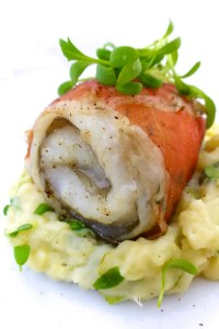 Here is an oven baked haddock recipe wrapped in a slice of cured ham, served over a creamy watercress mash... Epic!