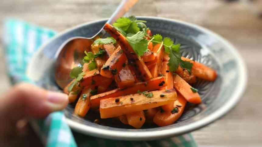 Spiced pan roasted carrots coated with a melted homemade lemon and cilantro butter... A great side dish for juicy pork chops!