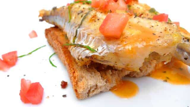 Here's my red gurnard recipe: oven baked red gurnard on a crunchy piece of toast with a homemade tomato vinaigrette... Delicious!