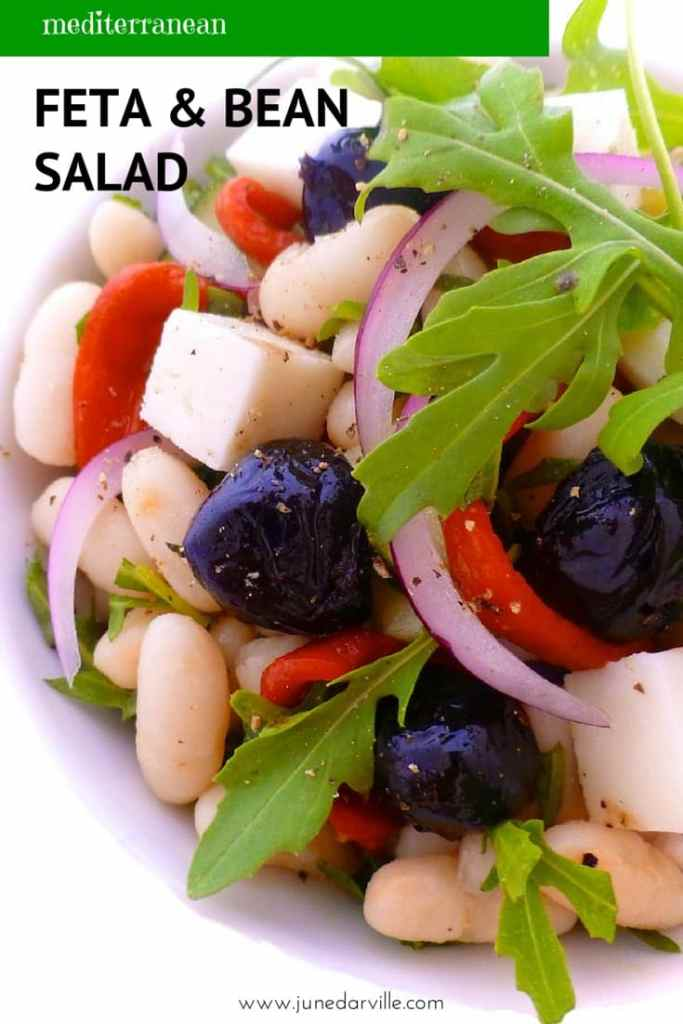 A great summer bean and feta salad packed with black olives, piquillo peppers, fresh arugula and a zesty lemon juice dressing!