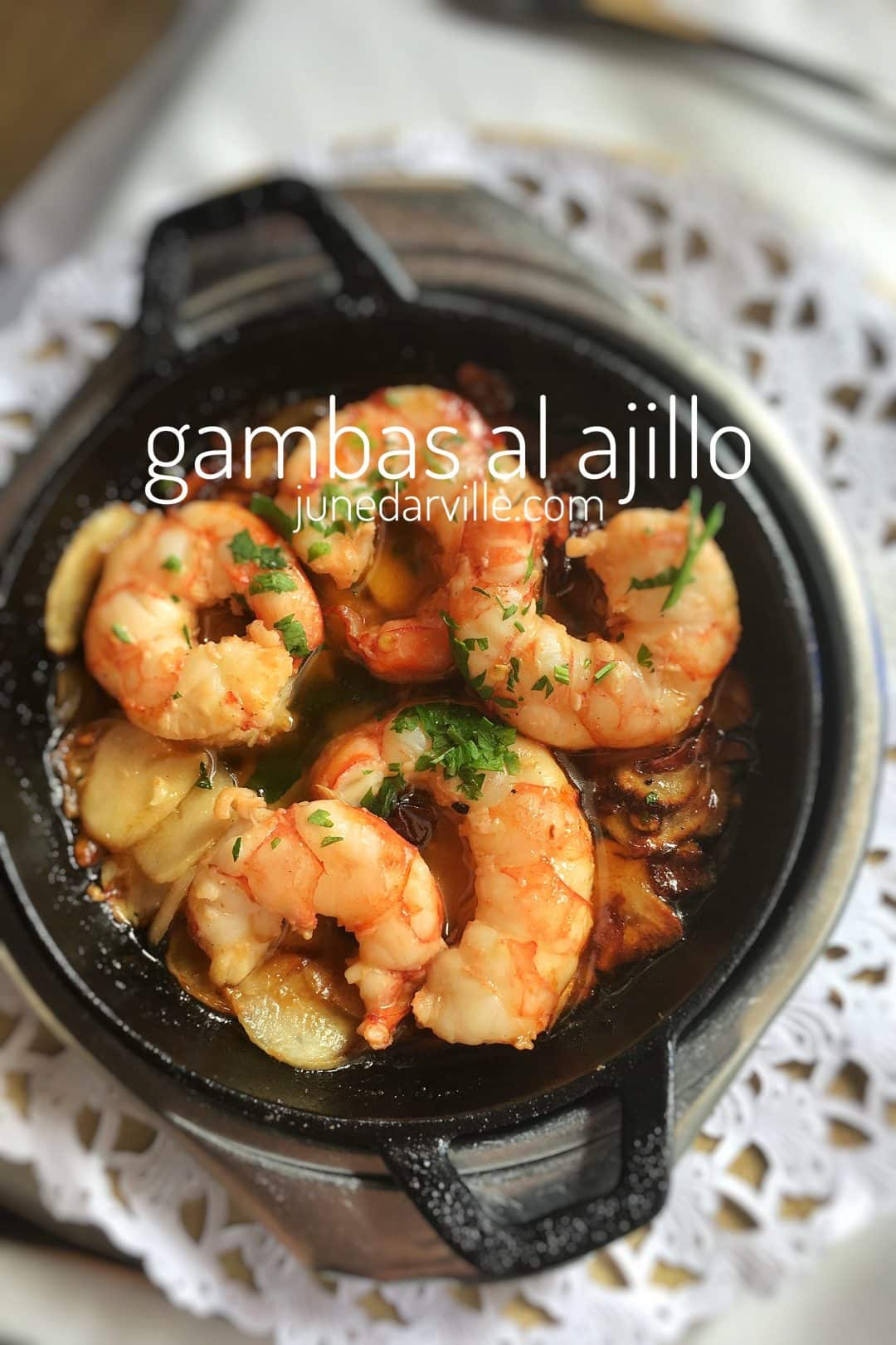 Learn how to make delicious gambas al ajillo, a classic Spanish garlic prawns recipe with olive oil, garlic and fresh parsley!