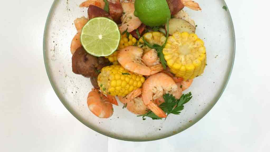 Finger lickin' good... classic shrimp boil with corn, potatoes, sausage and Old Bay seasoning of course!! Delicious summer fest...