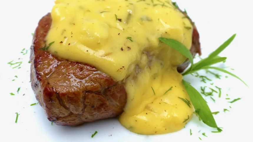 You will love this classic bearnaise sauce recipe! It is a delicious tarragon and butter sauce for your next steak dinner. Sauce béarnaise in French.