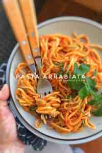 A classic spicy pasta arrabiata recipe with oven roasted tomatoes and chili sauce... This pasta dinner is flaming hot, with homemade sauce and super delicious!