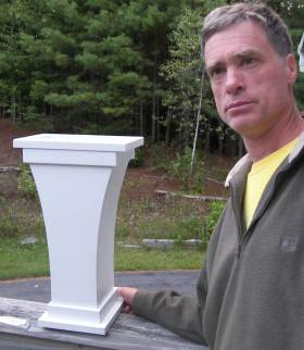 Mike Holm with the urn that he designed and built