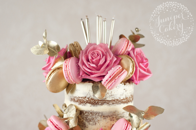 Birthday naked cake with pink and gold macarons by Juniper Cakery